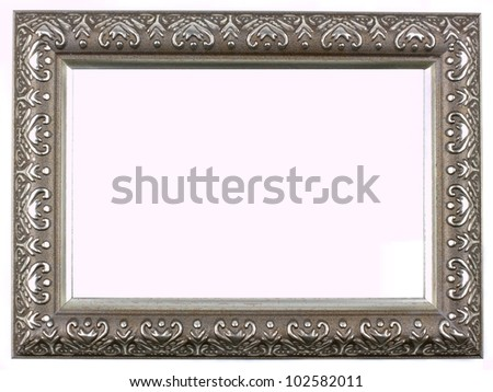 Antique silver picture frame with a decorative pattern on white background. - stock photo