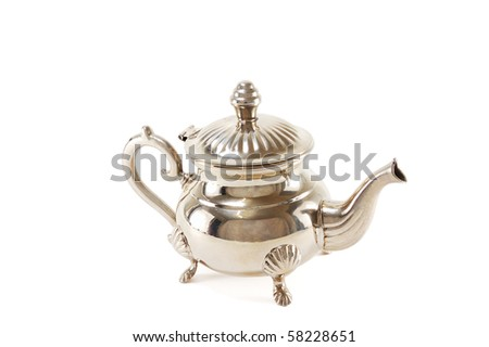 Antique silver teapot isolated on a white background