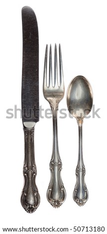 Antique silverware isolated on a white background. - stock photo