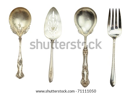 Antique silverware isolated on white with clipping path included. - stock photo
