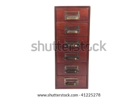 Antique six drawer oak library file card cabinet with brass label holders isolated over white background. - stock photo