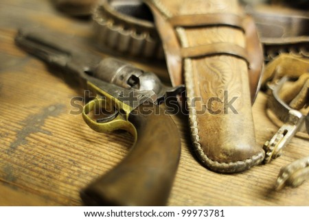 Antique six shooter pistol on a table. - stock photo