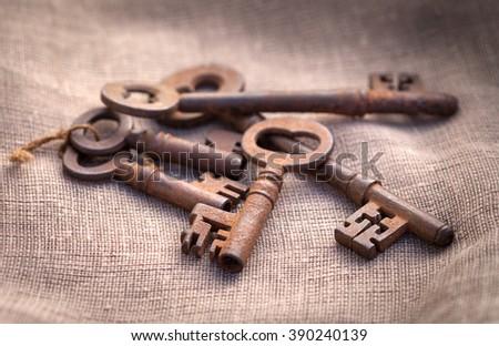 Antique skeleton keys on burlap - stock photo