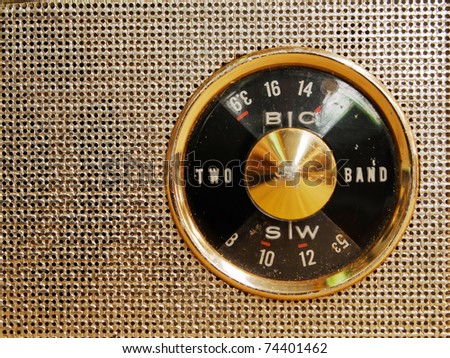 Antique small radio dial and a front speaker - stock photo