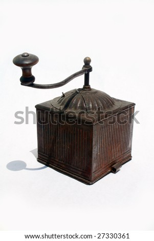 Antique spice grinder against white background - stock photo