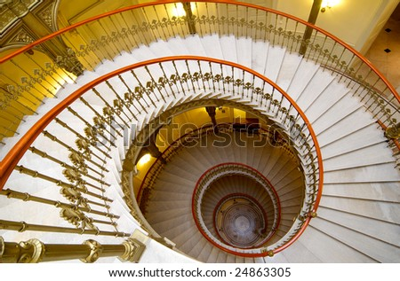 Antique spiral stairway - stock photo