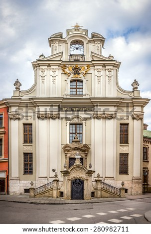 Antique St John church in old Cracow ( Krakow ) city, Poland - stock photo