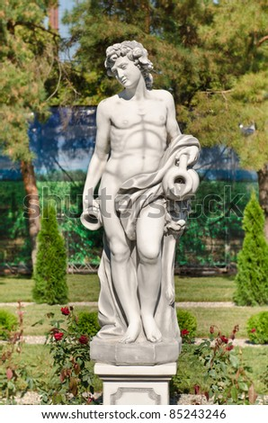 Antique statue - god of winemaking of Bacchus - stock photo