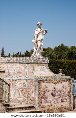 Antique statue in park of Queluz, Sintra, Portugal - stock photo