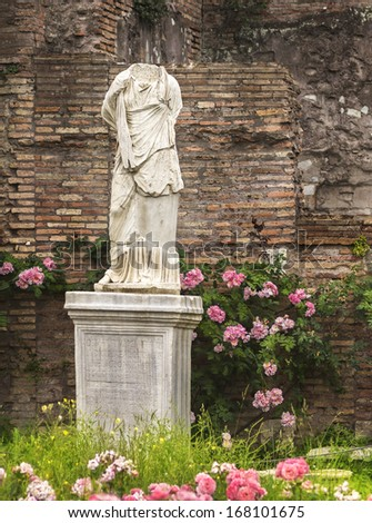 Antique statue of woman against backdrop of  ruins, Forum Romano - stock photo