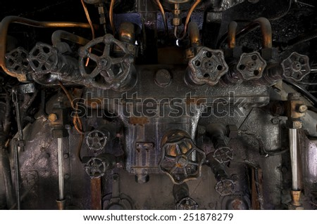 Antique steam locomotive metal cocpit knobs - stock photo