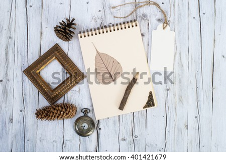 Antique still life on wooden table. Vintage paper and envelope on wood background - stock photo