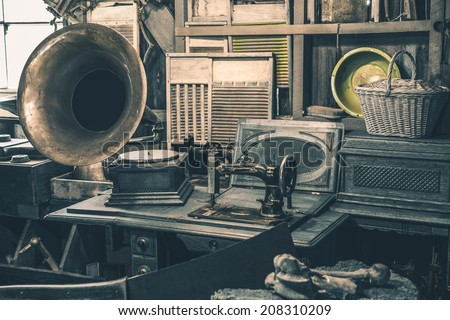 Antique Store Inventory. Old Gramophone, Sewing Machine and Other Early Twenty Century Stuff. - stock photo