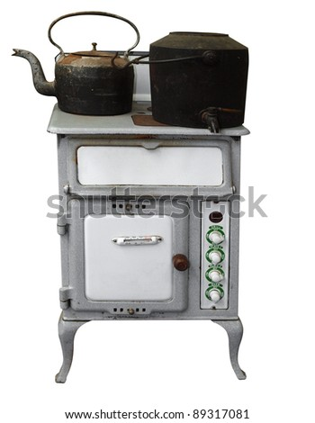 Antique Stove with Pot & Kettle isolated with clipping path - stock photo
