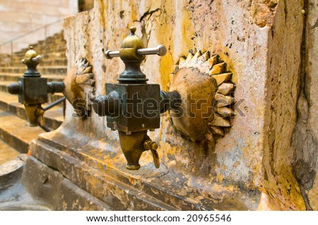 antique street faucet, Placa de Santiago Rusinol, Tarragona, Spain - stock photo