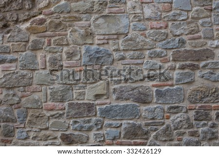 Antique street wall from bricks in Arezzo, Italy