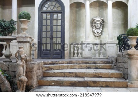Antique style in interior courtyard - stock photo