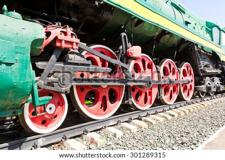 Antique style old train on rusty railway - stock photo