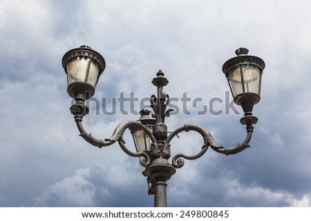 Antique style street lamp in Rome, Italy - stock photo