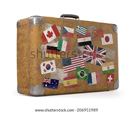 Antique suitcase with stamps flags representing each country traveled. Clipping path included.