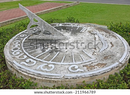 antique sundial decorating a garden - stock photo