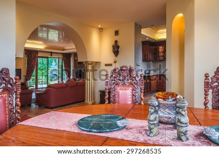 Antique table and chairs in exclusive interior - stock photo