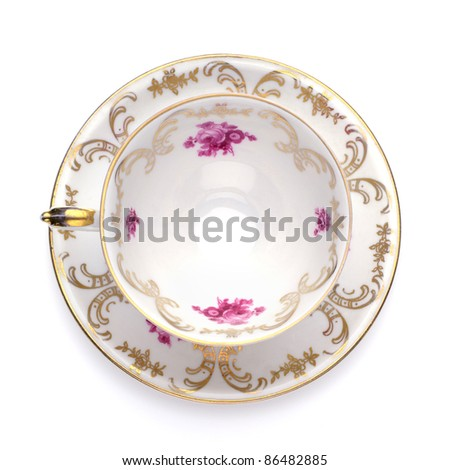 Antique tea cup from top on white background - stock photo