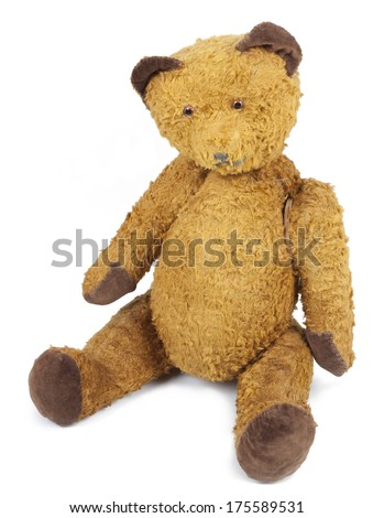 Antique Teddy bear wears his ragged fur. Photo isolated on white background. - stock photo