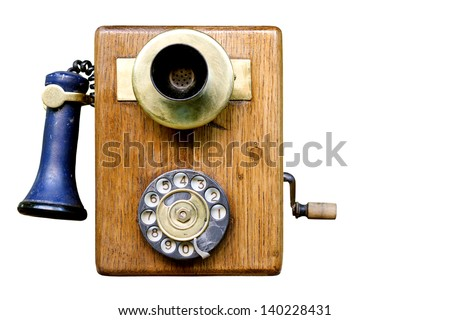 antique telephone on white background - stock photo