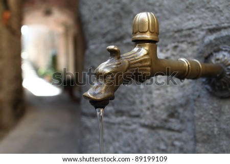 Antique the water tap, Italy - stock photo