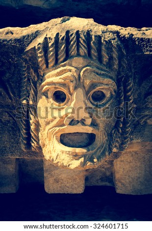 Antique theatrical mask - decoration of ancient theater for tragedy performance. - stock photo