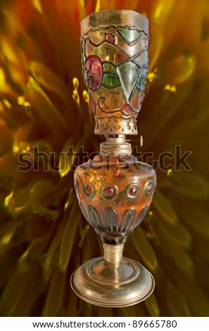 antique three colors  oil lamp isolated on texture background