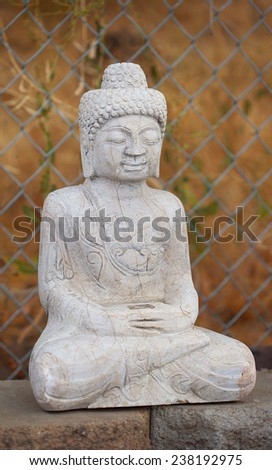 Antique Tibetan style Shakyamuni Buddha statue. Gautama Buddha, also known as Siddhartha Gautama, Shakyamuni, or simply the Buddha, was a sage on whose teachings Buddhism was founded. - stock photo