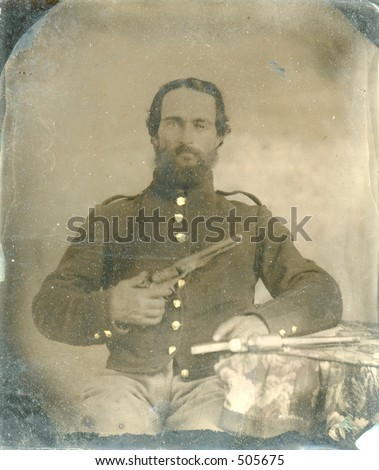 Antique tintype of Civil War soldier holding gun. Around 1860. Lots of intact wear and grunge. - stock photo