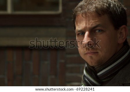 Antique toned portrait of an attractive man in winter clothes. - stock photo