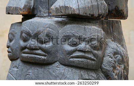 Antique totem faces - stock photo