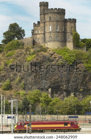 Antique tower and train line in Edinburgh, Scotland. UK. Vertical - stock photo