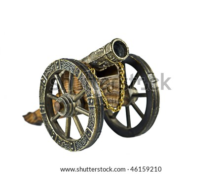 Antique toy cannon isolated on white - stock photo