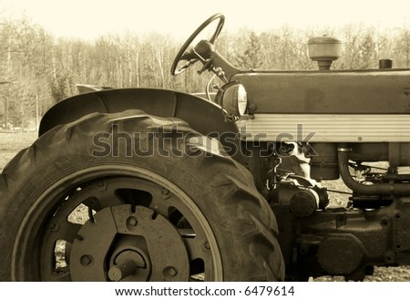 Antique tractor in sepia tone