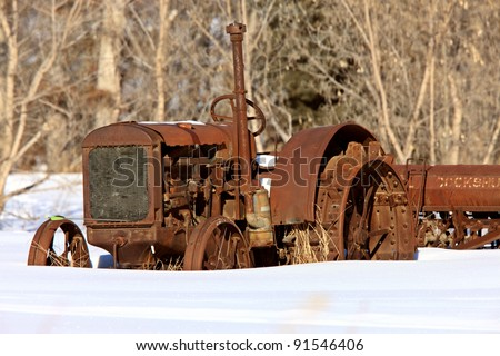 Antique Tractor in Winter - stock photo