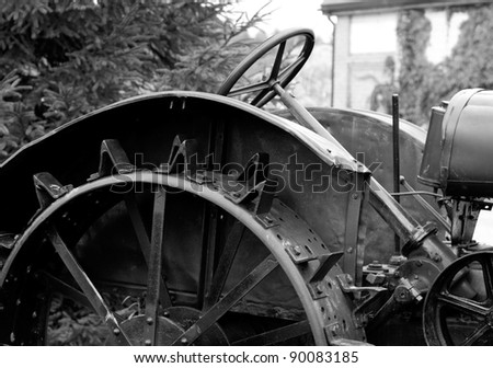 antique tractor steel wheel with spikes. detail - stock photo