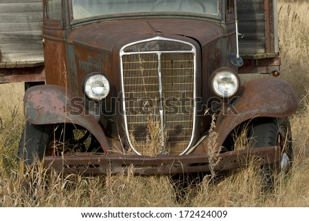 Antique Truck rusting on the prairie - stock photo