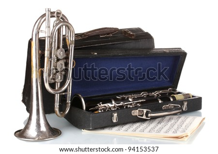 antique trumpet and clarinet in case isolated on white - stock photo