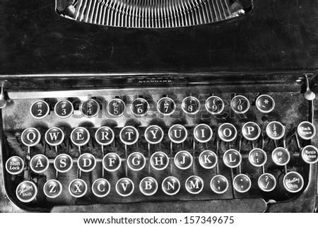 Antique Typewriter - An Antique Typewriter Showing Traditional QWERTY Keys V - stock photo