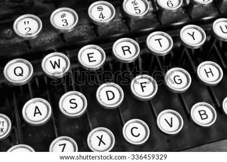 Antique Typewriter - An Antique Typewriter Showing Traditional QWERTY Keys XI - stock photo