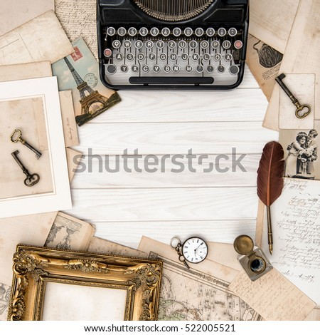 Antique typewriter and vintage office tools on wooden table. Flat lay. Top view