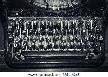 antique typewriter keys, shallow focus - stock photo