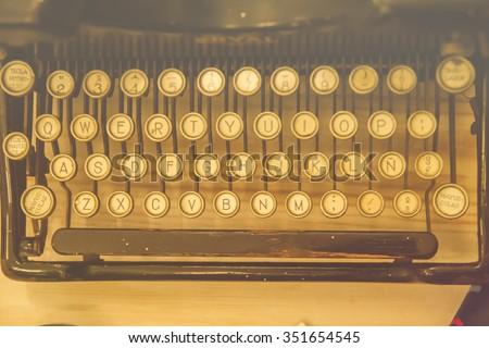 antique typewriter keyword - stock photo
