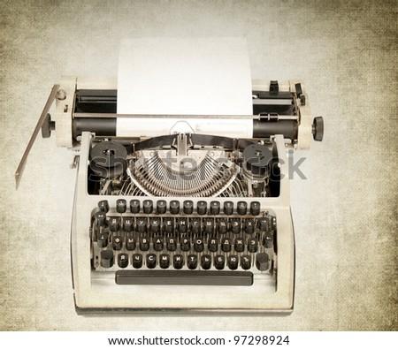 Antique typewriter on grunge background - stock photo