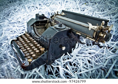 Antique typewriter on paper parts background - stock photo
